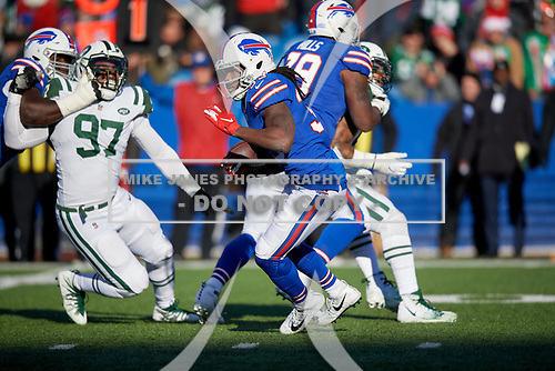 Buffalo Bills Chris Ivory (33) rushes up field during an NFL football game against the New York Jets, Sunday, December 9, 2018, in Orchard Park, N.Y.  (Mike Janes Photography)