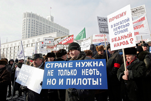epa000366788 Russian drivers and pilots hold placards during a demonstration in front of the Russian Government House in Moscow, Thursday 10 February 2005, demanding to stop the raising of the petrol prices in Russia.  EPA/SERGEI CHIRIKOV