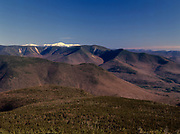 Scenic view of the Pemigewasset Wilderness in the New Hampshire White Mountains from Mount Liberty. Owl's Head is in the middle of the scene, and Mount Washington is snow-capped.