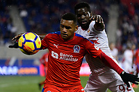 Harrison, NJ - Thursday March 01, 2018: Carlos Will Mejía, Kemar Lawrence. The New York Red Bulls defeated C.D. Olimpia 2-0 (3-1 on aggregate) during a 2018 CONCACAF Champions League Round of 16 match at Red Bull Arena.