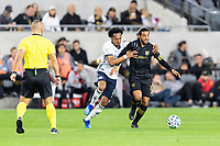 LOS ANGELES, CA - MARCH 08: Jose Martinez #8 of Philadelphia Union defends Carlos Vela #10 of LAFC during a game between Philadelphia Union and Los Angeles FC at Banc of California Stadium on March 08, 2020 in Los Angeles, California.