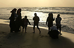 Palestinians enjoy their time on the beach in Gaza City on December 31, 2017 on the last day of the year. Photo by Ashraf Amra