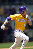 LSU Tigers outfielder Raph Rhymes #4 runs to first base against the Auburn Tigers in the NCAA baseball game on March 24, 2013 at Alex Box Stadium in Baton Rouge, Louisiana. LSU defeated Auburn 5-1. (Andrew Woolley/Four Seam Images).