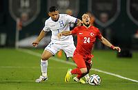 Washington, D.C.- May 29, 2014. Turkey defender Tarik Camdal gets fouled by Honduras defender Emilio Izaguirre.  Turkey defeated Honduras 2-0 during an international friendly game at RFK Stadium.