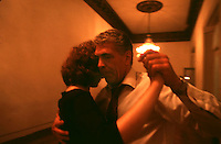 Tango dancers take part in a dancing class at the National Academy of Tango in Buenos Aires, May 16, 2003. At the Academy people from all ages study just tango: dance, music, composing, and writing.  Photo by Quique Kierszenbaum