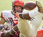 Syracuse quarterback Eric Dungey watches his fumble being recovered by Florida State in the second half of an NCAA college football game against Syracuse in Tallahassee, Fla., Saturday, Oct. 31, 2015.  Florida State defeated Syracuse 45-21. (AP Photo/Mark Wallheiser)