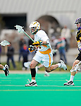 10 April 2011: University of Vermont Catamount F/O Andrew Muscara, a Freshman from Chandler, AZ, in action against the University at Albany Great Danes on Moulton Winder Field in Burlington, Vermont. The Catamounts defeated the visiting Danes 11-6 in America East play. Mandatory Credit: Ed Wolfstein Photo