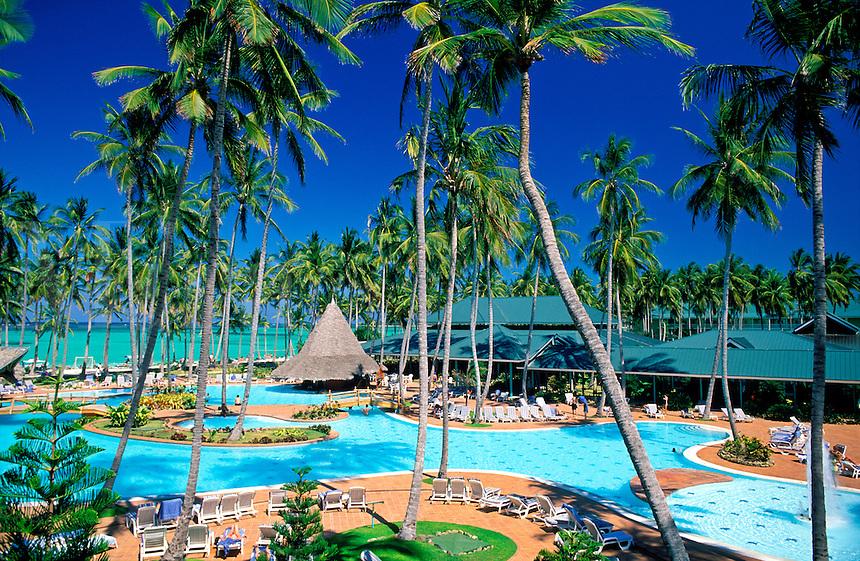 Dominican Republic, Punta Cana, Bavaro Beach. Barcelo Bavaro Beach Resort. Pool area, palm trees and beach with Caribbean Sea.NO PROPERTY RELEAS