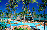 Dominican Republic, Punta Cana, Bavaro Beach. Barcelo Bavaro Beach Resort. Pool area, palm trees and beach with Caribbean Sea.NO PROPERTY RELEAS