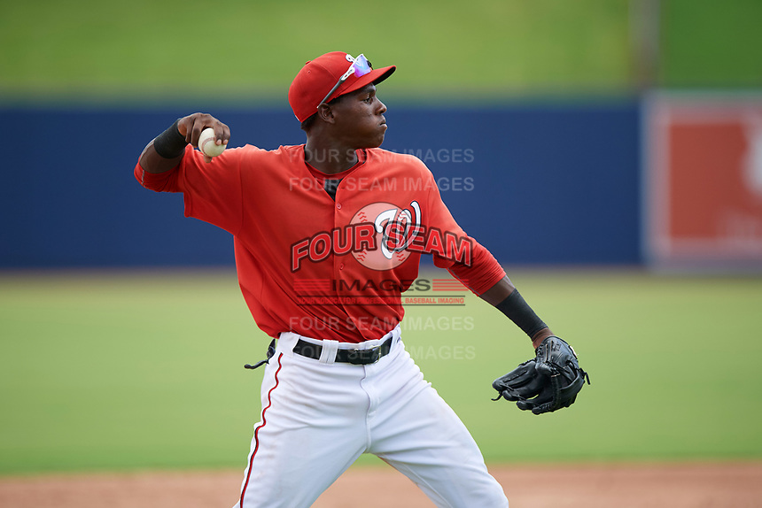 GCL Nationals third baseman Juan Pascal (19) warmup throw to first base during the second game of a doubleheader against the GCL Mets on July 22, 2017 at The Ballpark of the Palm Beaches in Palm Beach, Florida.  GCL Mets defeated the GCL Nationals 4-1.  (Mike Janes/Four Seam Images)