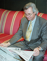 Montreal, 1999-05-31 File Photo. Canadian Minister of Human Ressources Development ;  the Honorable Pierre Pettigrew take the time to read the local paper before the official opening diner of the `` 5th Conference of Montreal `` on economy globalization.<br /> <br /> Photo :  (c) Pierre Roussel, 1999