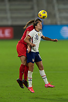 ORLANDO CITY, FL - FEBRUARY 18: Carli Lloyd #10 battles for a header during a game between Canada and USWNT at Exploria stadium on February 18, 2021 in Orlando City, Florida.