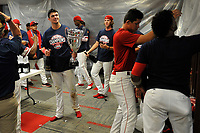 Third baseman Bobby Dalbec holds the trophy in the clubhouse as Greenville Drive players celebrate their 2017 South Atlantic League Championship following an 8-3 win over the Kannapolis Intimidators in Game 4 of the Championship Series on Friday, September 15, 2017, at Fluor Field at the West End in Greenville, South Carolina. It was Greenville's first SAL Championship. Greenville won the series 3-1. (Tom Priddy/Four Seam Images)