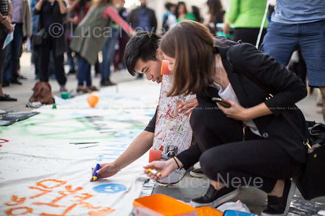London, 15/08/2015. Today, London's Iranian people and member of the public held a demonstration in Trafalgar Square to mark the Global Day of Peace for/with Iran 2015 and to support the 'Deal' signed in July 2015. The event was organised worldwide in about 50 cities. <<The Iran nuclear deal framework was a preliminary framework agreement reached between the Islamic Republic of Iran and a group of world powers: the P5+1 (the permanent members of the United Nations Security Council–the United States, the United Kingdom, Russia, France, and China) plus Germany), plus the European Union. […]On July 14, 2015, the Joint Comprehensive Plan of Action between Iran and the P5+1 and EU, a comprehensive agreement based on the April 2015 framework, was announced. […]>> (Source Wikipedia.org).<br /> <br /> For more information please click here: http://on.fb.me/1HPt3sf & http://www.supportirandeal.com/