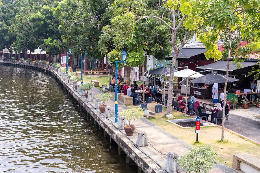 Riverwalk and Casual Outdoor Restaurant along the Melaka River,  Melaka, Malaysia.