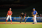 First baseman Triston Casas (26) of American Heritage High School in Pembroke Pines, Florida holds on Jarred Kelenic (10) of Waukesha West High School in Waukesha, Wisconsin during the Under Armour All-American Game presented by Baseball Factory on July 29, 2017 at Wrigley Field in Chicago, Illinois.  (Mike Janes/Four Seam Images)