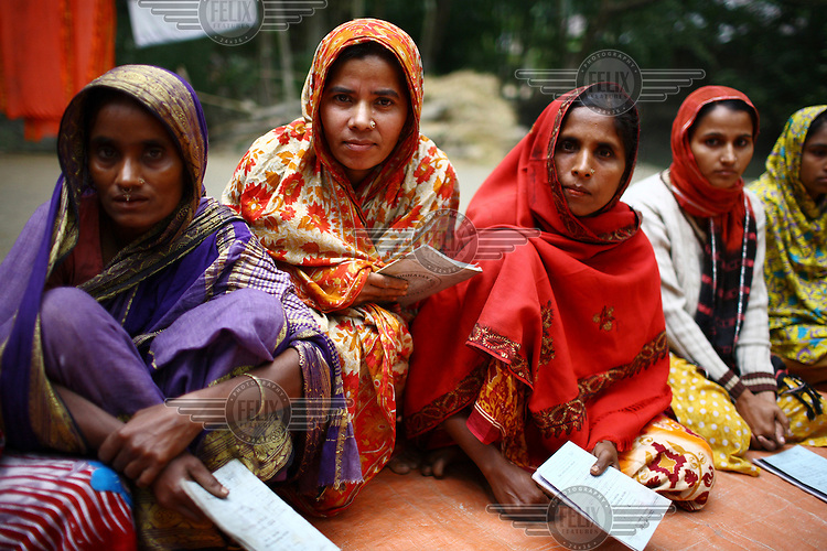 A women's group meeting in Bakerganj to discuss small microfinance loans from group savings.