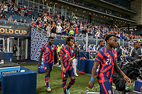 KANSAS CITY, KS - JULY 15: George Bello #21, Gianluca Busio #6 and and Daryl Dike #11 of the United States walk out during a game between Martinique and USMNT at Children's Mercy Park on July 15, 2021 in Kansas City, Kansas.