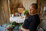 Eva de Leon, 75, stands in front of the photograph of  her husband Crus de Leon, 75, who died during  a 7.4 earthquake struck Guatemala Wednesday Nov. 7.