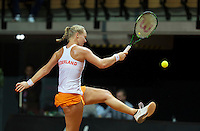 Arena Loire,  Trélazé,  France, 16 April, 2016, Semifinal FedCup, France-Netherlands, Kiki Bertens (NED) kiks the ball<br /> Photo: Henk Koster/Tennisimages