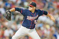 Minnesota Twins starting pitcher Brian Duensing #52 delivers a pitch during a Major League Baseball game against the Texas Rangers at the Rangers Ballpark in Arlington, Texas on July 27, 2011. Duensing was the winning pitcher as his Minnesota Twins defeated Texas 7-2.  (Andrew Woolley/Four Seam Images)