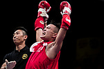 The judge rises the arm of Liu Hin Chung (Red) of Hong Kong as he wins the gold medal in the male muay 54KG division weight bout during the East Asian Muaythai Championships 2017 at the Queen Elizabeth Stadium on 13 August 2017, in Hong Kong, China. Liu Hin Chung won the gold over opponent Xiao Feng of China. Photo by Yu Chun Christopher Wong / Power Sport Images