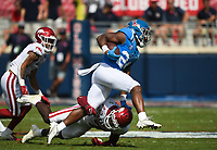 Ole Miss running back Snoop Conner (24) leaps past Arkansas defensive back Joe Foucha (7), Saturday, October 9, 2021 during the third quarter of a football game at Vaught Hemingway Stadium in Oxford, Miss. Check out nwaonline.com/211010Daily/ for today's photo gallery. <br /> (NWA Democrat-Gazette/Charlie Kaijo)