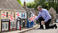 BNPS.co.uk (01202) 558833. <br /> Pic: CorinMesser/BNPS<br /> <br /> Tiny town gets ready for the big match...<br /> <br /> Wimborne Model Town manager Nick Clark rolls out the miniature bunting ahead to show support for England at European Championships