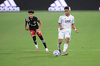 WASHINGTON, DC - AUGUST 25: Brandon Bye #15 of New England Revolution plays the ball against Kevin Paredes #30 of D.C. United during a game between New England Revolution and D.C. United at Audi Field on August 25, 2020 in Washington, DC.