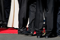 The Pope Benedict XVI's white cassock seen among the black trousers of his guards during the welcome ceremony at the Prague Airport, Czech Republic, 26 September 2009.