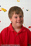Down syndrome boy,  9 years old, portrait, closeup  Caucasian vertical