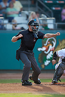 Home plate umpire Steven Jaschinski calls a batter out on strikes during the Carolina League game between the Winston-Salem Dash and the Down East Wood Ducks at Grainger Stadium Field on May 17, 2019 in Kinston, North Carolina. The Dash defeated the Wood Ducks 8-2. (Brian Westerholt/Four Seam Images)