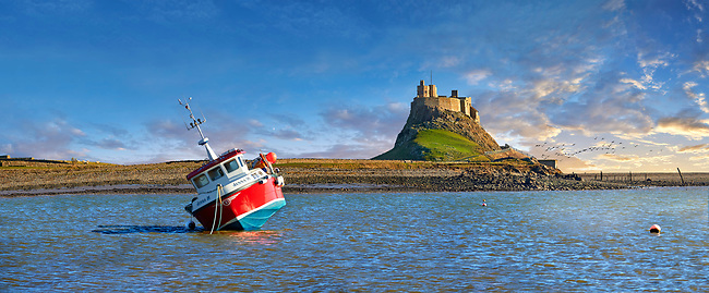 Lindisfarne Castle &  fishing boat - 16th Century castle, Holy Island, Lindisfarne, Northumberland, England