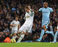 Picture by Howard Roe/AHPIX.com. Football, Barclays Premier League; <br /> Manchester City v Swansea City ;22/11/2014 KO 3.00 pm <br /> Etihad Stadium;<br /> copyright picture;Howard Roe;07973 739229<br /> Swansea's Gylfi Sigurdsson has a shot at the City goal