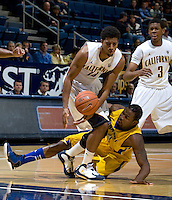 Christian Behrens of California controls the ball away from Mo Hughley of CSUB during the game at Haas Pavilion in Berkeley, California on November 11th, 2012.  California defeated CSUB, 78-65.