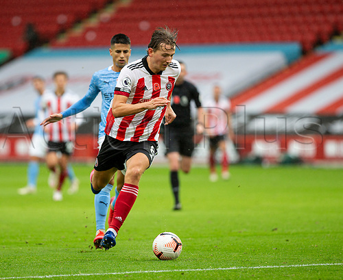 31st October 2020; Bramall Lane, Sheffield, Yorkshire, England; English Premier League Football, Sheffield United versus Manchester City; Sander Berge of Sheffield United oil the break with the ball at his feet as he gets aways from Joao Cancelo of Manchester City