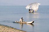 Mahale, Tanzania. Dugout canoe and small sailing dhow.