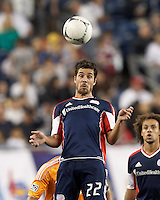 New England Revolution forward Benny Feilhaber (22) heads the ball. In a Major League Soccer (MLS) match, the New England Revolution tied Houston Dynamo, 2-2, at Gillette Stadium on May 19, 2012.
