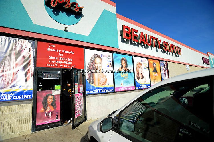 A woman exits a beauty supply store on 79th Street on the southern edge of the South Shore neighborhood of Chicago, Illinois on January 2, 2008.  Michelle Obama, wife of U.S. President Elect Barack Obama, was raised in a modest bungalow in the South Shore neighborhood on the South Side of Chicago.