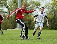 Pictured: Garry Monk. Tuesday 06 May 2014<br /> Re: Members of the local press play football against Swansea City FC coaches and members of staff at the Club's training ground in Fairwood, south Wales.