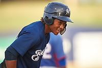 AZL Brewers Blue Orveo Saint (30) stands on third base after hitting a triple during an Arizona League game against the AZL Rangers on July 11, 2019 at American Family Fields of Phoenix in Phoenix, Arizona. The AZL Rangers defeated the AZL Brewers Blue 5-2. (Zachary Lucy/Four Seam Images)