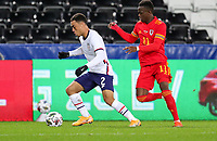 SWANSEA, WALES - NOVEMBER 12: Sergino Dest #2 of the United States  moves past Rabbi Matondo #11 of Wales during a game between Wales and USMNT at Liberty Stadium on November 12, 2020 in Swansea, Wales.