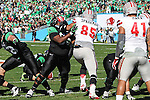 North Texas Mean Green offensive linesman Micah Thompson (65) and UNLV Rebels defensive lineman Jordan Sparkman (85) in action during the Heart of Dallas Bowl game between the North Texas Mean Green and the UNLV Rebels at the Cotton Bowl Stadium in Dallas, Texas. UNT defeats UNLV 36 to 14.