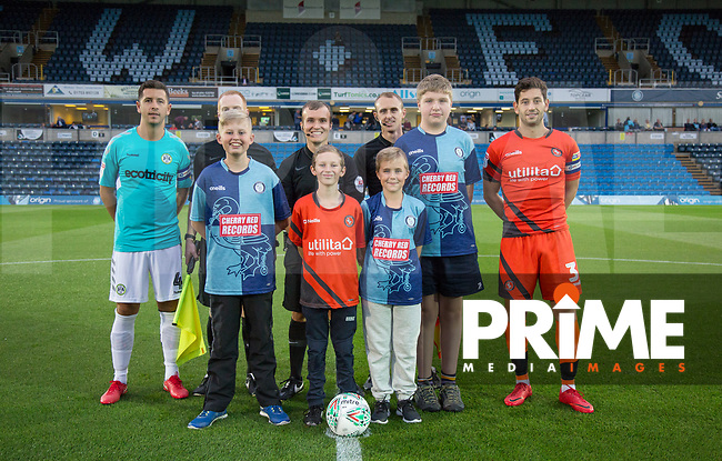 Captains Joe Jacobson of Wycombe Wanderers & Lloyd James of Forest Green Rovers with officials and mascots during the Carabao Cup 2nd round match between Wycombe Wanderers and Forest Green Rovers at Adams Park, High Wycombe, England on 28 August 2018. Photo by Kevin Prescod.