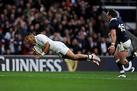 Anthony Watson of England dives dramatically over the tryline, although the try is disallowed shortly afterwards