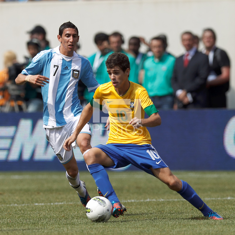 Brazil midfielder Oscar (10) dribbles at midfield.  In an international friendly (Clash of Titans), Argentina defeated Brazil, 4-3, at MetLife Stadium on June 9, 2012.