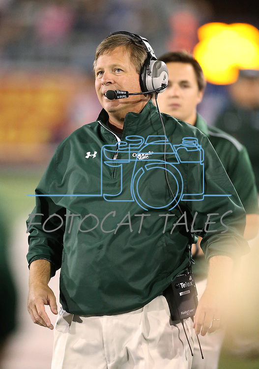 Colorado State Head Coach Jim McElwain coaches an NCAA college football game against Nevada, in Reno, Nev., on Saturday, Oct. 11, 2014. Colorado State won 31-24. (AP Photo/Cathleen Allison)
