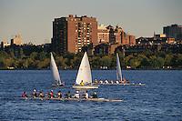 Massachusetts, Boston; Collegiate Sculling Crew On Charles River;  Back Bay & Boston Skyline In Backgroun