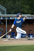 Matt Goodheart (25) (Arkansas) of the Martinsville Mustangs follows through on his swing against the High Point-Thomasville HiToms at Finch Field on July 26, 2020 in Thomasville, NC.  The HiToms defeated the Mustangs 8-5. (Brian Westerholt/Four Seam Images)