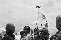 Habila, West Darfur, August 10, 2004.IDP beneficiaries of a WFP food distribution operation during a plane airdrop. More than 140 metric tons of food in 2800 50 Kg bags have been dropped in one day from four big Yliuchin cargo planes. During the month of July 2004 alone, the WFP distributed food to more than 951 000 people in Darfur.